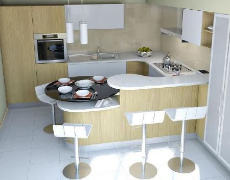 Poze Bucatarie - Bucataria unui apartament cu masa gandita ca o prelungire a barului