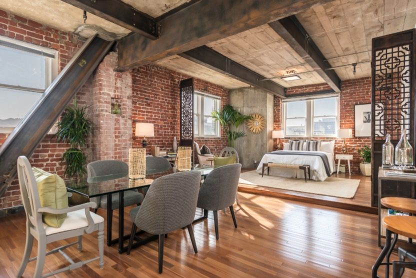 Sufrageria unui apartament modern amenajat intr-o veche fabrica de bere