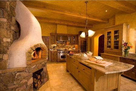 Poze Bucatarie - Bucatarie in stil toscan intr-o casa naturala construita din baloti de paie si caramizi din lut