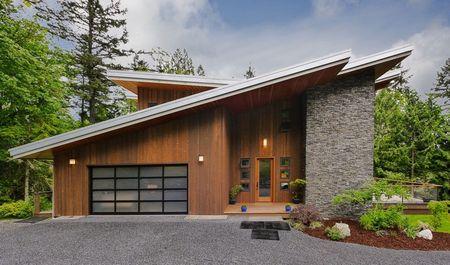 Poze Fatade - Lemn si piatra pentru o casa cu arhitectura moderna
