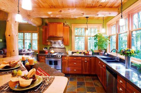 Poze Bucatarie - Spatiile vitrate generoase conecteaza bucataria cu padurea din jur