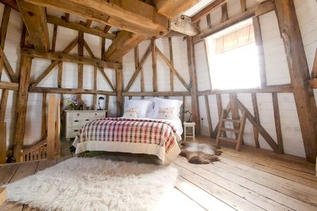 Poze Dormitor - Dormitorul unei case de vacanta amenajata intr-o moara veche de vant