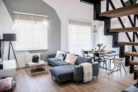 Poze Living - Tonurile neutre imprima eleganta acestui apartament modern