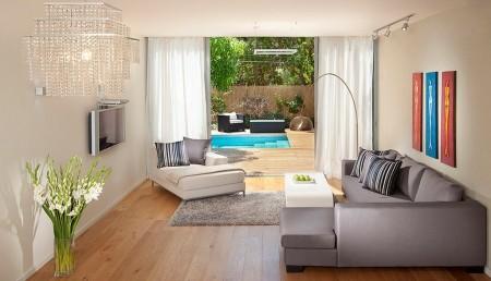 Poze Living - Usile culisante deschid acest living amenajat modern spre terasa si gradina