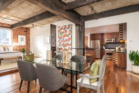 Poze Sufragerie - Locul de luat masa si bucataria intr-un apartament modern