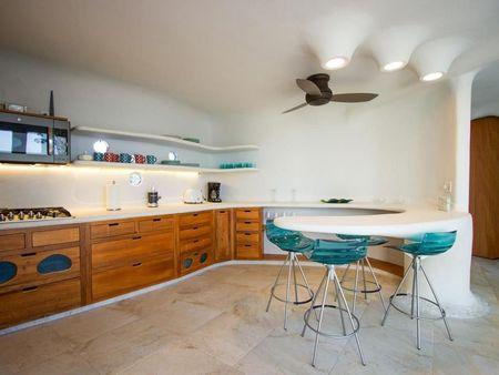 Poze Sufragerie - Sufrageria si bucataria unei case cu arhitectura organica