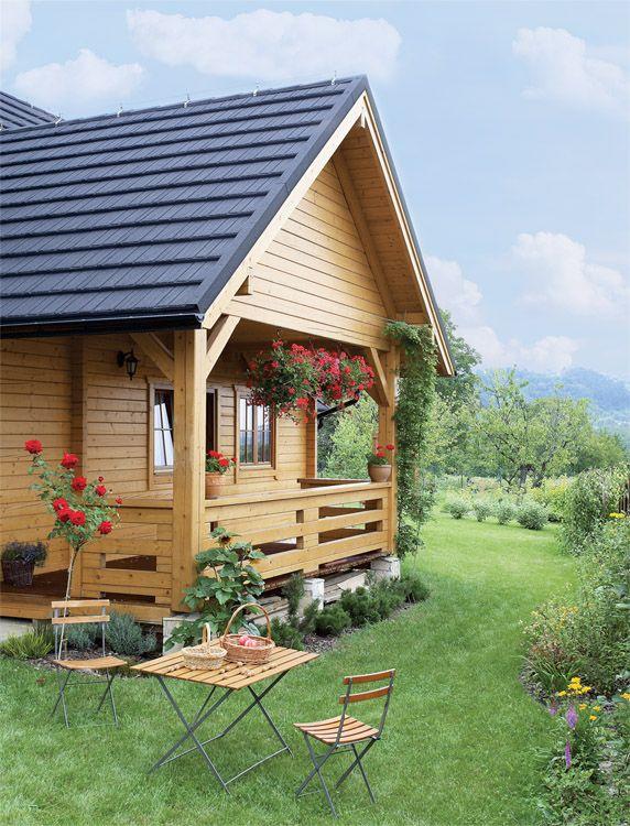 Casa de vis la tara construita din lemn masiv - galerie imagini