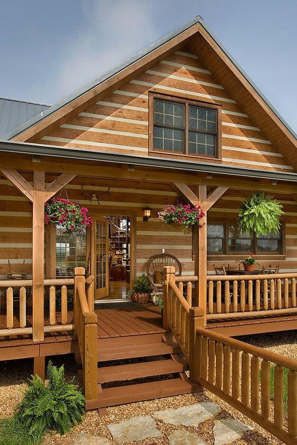 Casa de vacanta construita din lemn masiv si inconjurata de terase - imagini si proiect
