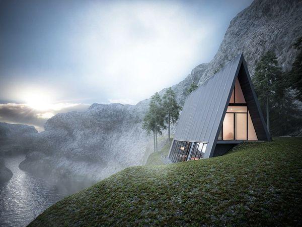 Casa de vacanta cu forma triunghiulara construita pe marginea unei stanci