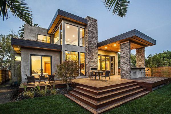 Interioare luminoase intr-o casa verde cu arhitectura moderna
