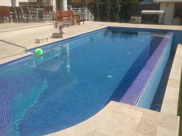 Constructii de piscine de beton o relaxare unica la for Constructii piscine romania