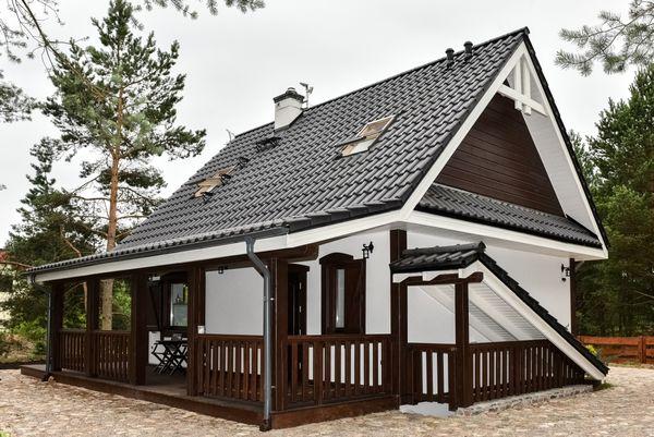 Casa traditionala mica, cu pivnita, terasa si podul amenajat - proiect si imagini